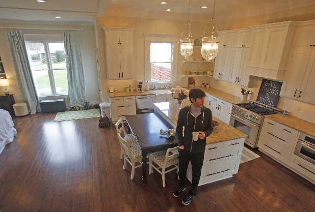Scott Bragg stands in the kitchen of his recently renovated home in Cleveland, Tenn. Sarah and Scott Bragg recently completed a renovation of their 100-year-old home in Cleveland, Tenn. The couple moved to Cleveland from Atlanta in 2010.