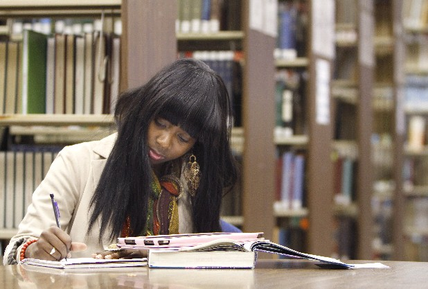 Ciera Conley, a senior, studies biology in the library at the University of Tennessee at Chattanooga.