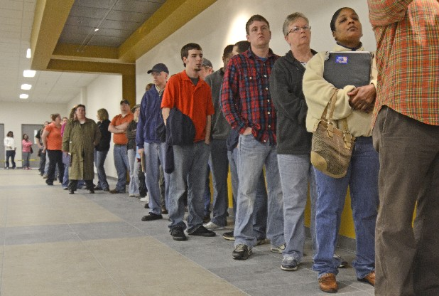 People wait in line to fill out applications Saturday at Whirlpool in Cleveland, Tenn. The oven-maker is hiring some 60 people as it prepares for a move to a new plant site.