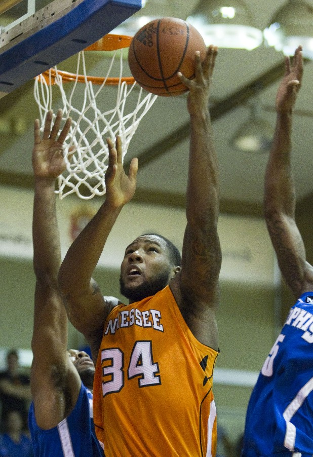Memphis' Chris Crawford, left, and Will Barton, right, defend as Tennessee's Jeronne Maymon (34) goes to the basket in the first half of an NCAA college basketball game Tuesday, Nov. 22, 2011, in Lahaina, Hawaii. (AP Photo/Eugene Tanner)