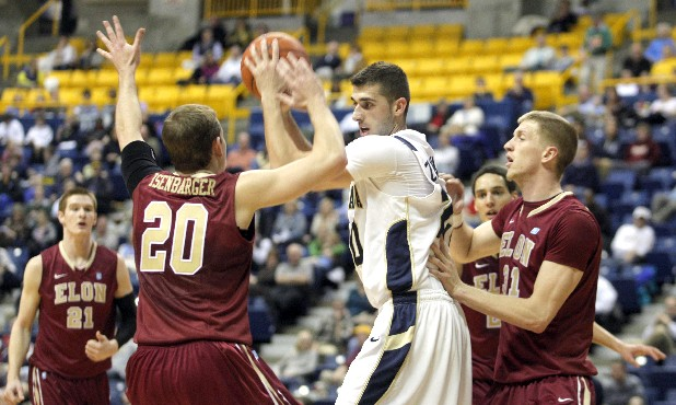 The Mocs' Drazen Zlorvaric, No. 20, keeps the ball away from Elon's Jack Isenbarger, No. 20, and Lucas Troutman, No. 31, during Thursday's game. The University of Tennessee at Chattanooga played against Elon at McKenzie Arena on Thursday night.