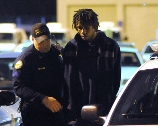 Chattanooga Police Officer Aaron Williams, left, brings in robbery suspect Jeremiah Miller at the Amnicola headquarters. Officer Williams captured the suspect in the Woodlawn development during the second night of a citywide crime saturation effort under the direction of Police Chief Bobby Dodd.