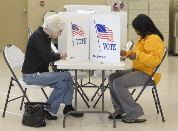 Voters mark their ballots during early voting at the Hamilton County Election Commission office on Amnicola Highway in this file photo.