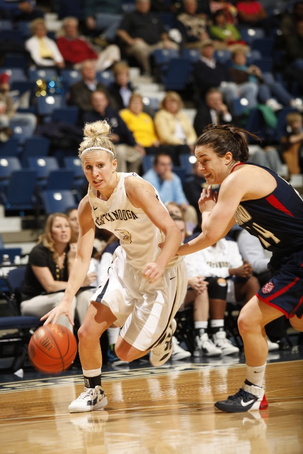 Lady Mocs junior Kayla Christopher, left, charges around Samford senior Ruth Ketcham during a game at McKenzie arena.