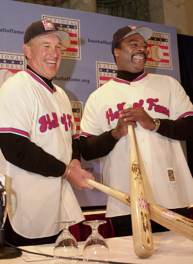 Gary Carter, left, and Eddie Murray, the 2003 inductees into the National Baseball Hall of Fame, hold baseball bats during a news conference in New York formally announcing their induction, Thursday, Jan. 16, 2003.