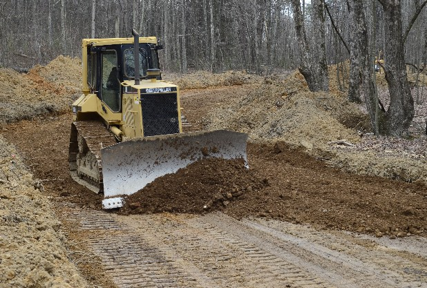 Alec Roberts, of Signal Excavating, works on making a road through the Boulder Point subdivision on Signal Mountain. The housing development is located on Shackleford Ridge Road near Nolan Elementary and Signal Mountain Middle/High School.