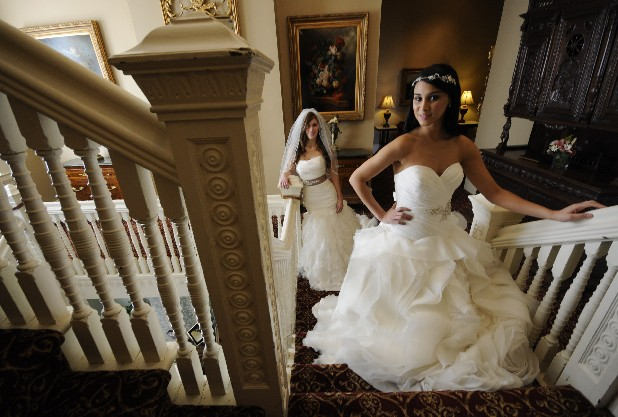Lillian Silva, right, and Lila Fisher model wedding gowns inside the Mayor's Mansion Inn.