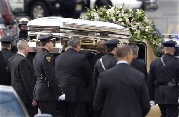 The coffin holding the remains of singer Whitney Houston is carried to a hearse after funeral services at the New Hope Baptist Church in Newark, N.J., Saturday, Feb. 18, 2012. Houston died last Saturday at the Beverly Hills Hilton in Beverly Hills, Calif., at the age 48.