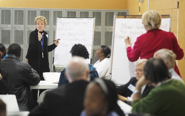Chattanooga Housing Authority's Betsy McCright, left, writes down ideas from Westside residents during a brainstorming session at Tuesday's meeting. Mayor Ron Littlefield met with residents at the James A. Henry Resource Center on Tuesday afternoon to talk about future plans for the area's development.