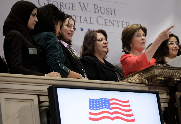 Former First Lady Laura Bush, second from right, rings the opening bell at the New York Stock Exchange before in New York today. U.S. stocks are opening higher and the Dow Jones industrial average is nearing 13,000 after Greece secured a bailout deal to keep it from default. (AP Photo/Seth Wenig)