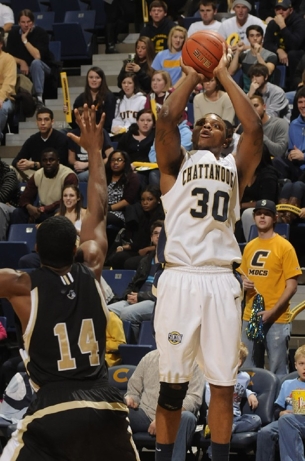 Zaccheus Mason of UTC shoots over Aerris Smith of Wofford at McKenzie Arena in January.