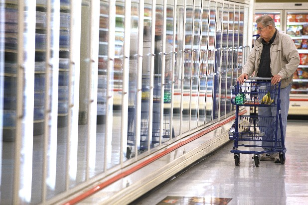 Clyde Whisenant looks through the frozen foods aisle of the Food Lion on Ringgold Road. The Ringgold Food Lion is the only remaining Hamilton County location for the grocery chain.