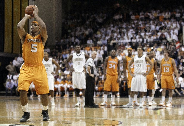 Tennessee forward Jarnell Stokes (5) shoots a technical foul shot as Tennessee and Vanderbilt players watch in the first half of an NCAA college basketball game on Tuesday, Jan. 24, 2012, in Nashville, Tenn. (AP Photo/Mark Humphrey)