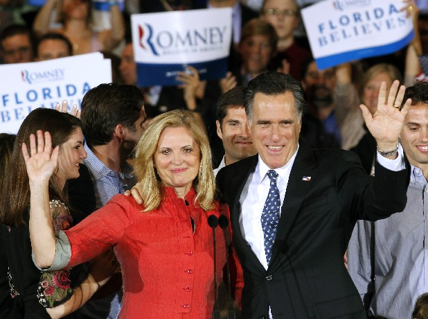 Republican presidential candidate, former Massachusetts Gov. Mitt Romney and his wife Ann wave to supporters during his victory celebration after winning the Florida primary election Tuesday Jan. 31, 2012, in Tampa, Fla. (AP Photo/Gerald Herbert)