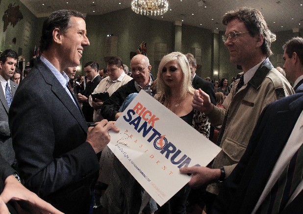 Republican presidential candidate and former Pennsylvania Sen. Rick Santorum greets supporters after speaking at Temple Baptist Church on Wednesday in Powell, Tenn.