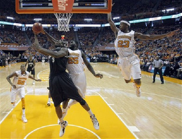 Vanderbilt center Festus Ezeli (3) goes in for a basket as Tennessee forward Dwight Miller (25) and guard Cameron Tatum (23) defend during the second half of an NCAA college basketball game at Thompson-Boling Arena in Knoxville, Tenn., Saturday, March 3, 2012.