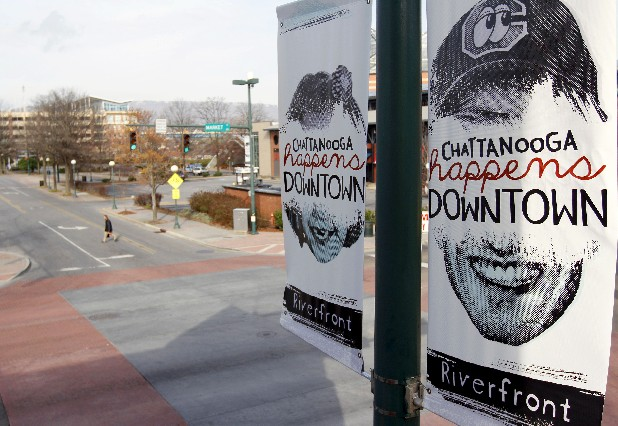 Banners promoting downtown Chattanooga hang off poles on Market Street. City Council Chairwoman Pam Ladd recently called the $60,000 signs atrocious and ugly.
