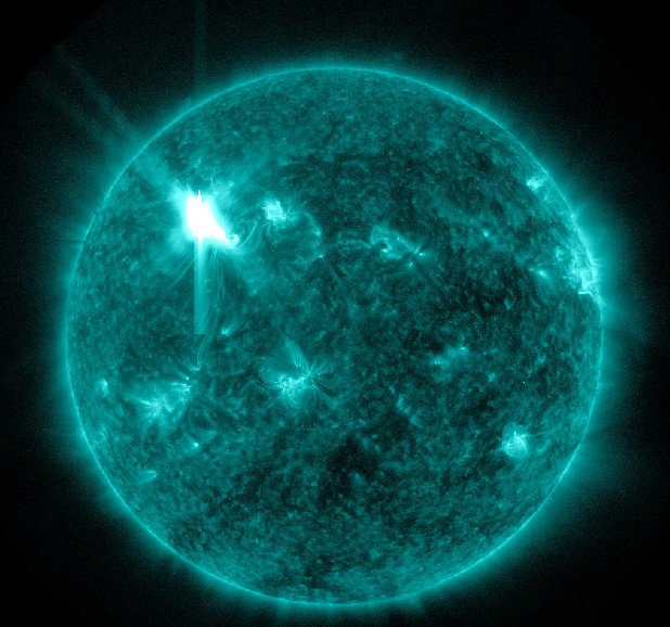 This extreme ultraviolet wavelength image provided by NASA shows a solar flare. An impressive solar flare is heading toward Earth and could disrupt power grids, GPS and airplane flights. Forecasters at the National Oceanic and Atmospheric Administration's (NOAA) Space Weather Prediction Center said the sun erupted Tuesday evening and the effects should start smacking Earth late Wednesday night, close to midnight EST. They say it is the biggest in five years and growing. (AP Photo/NASA)