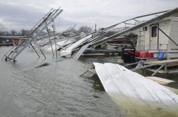 Damage to boats and slips is all around Island Cove Marina Thursday after the area was hit by an EF3 tornado a week ago today.