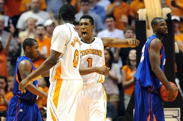 Tennessee guard Josh Richardson (1) celebrates with teammate Yemi Makanjuola (0) after he was fouled by Savannah State guard Patrick Hendley (10) during the second half of an NIT first-round college basketball tournament game, Tuesday, March 13, 2012, in Knoxville, Tenn. (AP Photo/Knoxville News Sentinel, Adam Brimer)