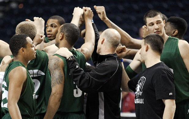 Ohio University players gather during practice for an NCAA college basketball tournament game in Nashville, Tenn. Ohio is the first state to have four teams advance to the tournament's Sweet 16.