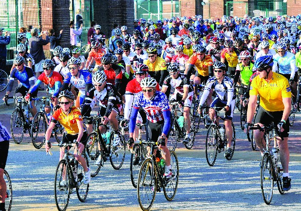 Cyclists begin the 2012 3-State, 3-Mountain Challenge near Finley Stadium.