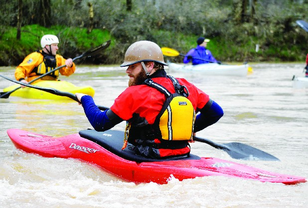 David Morris catches an eddy as members of the Tennessee Valley Canoe Club, Outdoor Chattanooga and the South Chickamauga Greenway Alliance paddle a section of the South Chickamauga Creek.