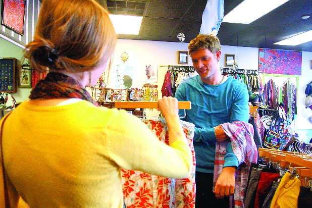 Lara Murray, left, shows Charles Bailey a skirt she likes at Collective Clothing, a vintage clothing store in St. Elmo.