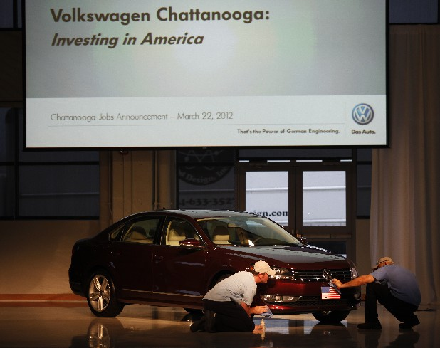 Garrett Jackson, left, and Genaro Vargus polish a Volkswagon Passat before the start of a press conference today at Volkswagon's Chattanooga area plant to announce the planned addition of 1,000 new jobs in the 2012 year.