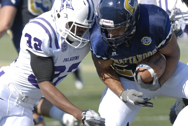 UTC's J.J. Jackson (26) is brought down by Furman's Greg Worthy (32).