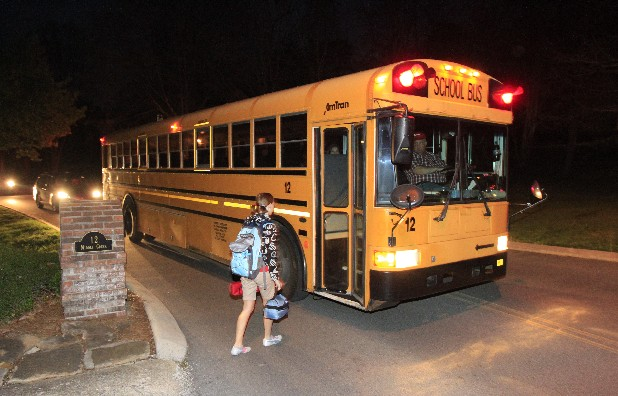 Signal Mountain Middle School sixth-grader Damaris Kleine prepares to board a school bus at 6:45 a.m. Thursday. Mary A. Carskadon has found a correlation between insufficient sleep in adolescents and health issues due to early school start times. She spoke at UTC on Thursday.