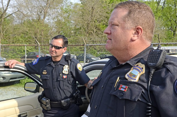 Master Patrol Officers David Ashley, left, and Lorin Johnston talk about their feelings and how they were affected by the tatal shooting of  Sgt. Tim Chapin a year ago. Ashley and Johnston were among the first officers to respond to a robbery call at the U.S. Money Shops on Brainerd Road on April 2, 2011, where Chapin was killed in a shootout.