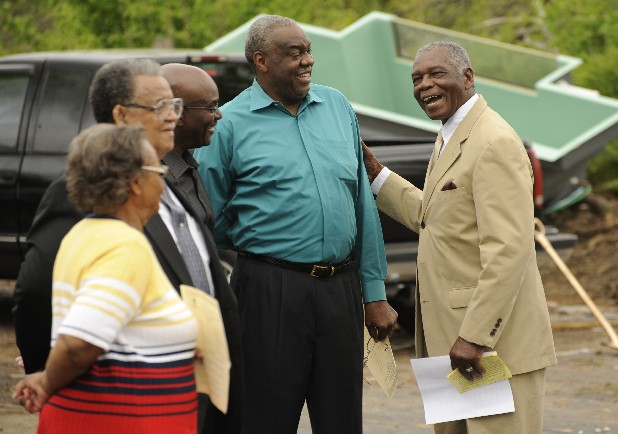 Rev. Jimmy Ingram, right, of Mount Peria Baptist Church, speaks with attendees at a groundbreaking ceremony Saturday. The church was destroyed in the April 27, 2011, tornadoes but will be rebuilt larger than before.
