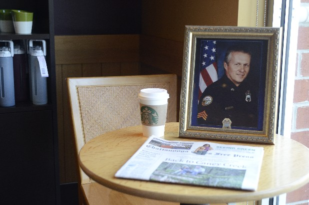 A cup of coffee and a paper are on a table at the Brainerd Road Starbucks in memory of Sgt. Tim Chapin, who was killed one year ago.