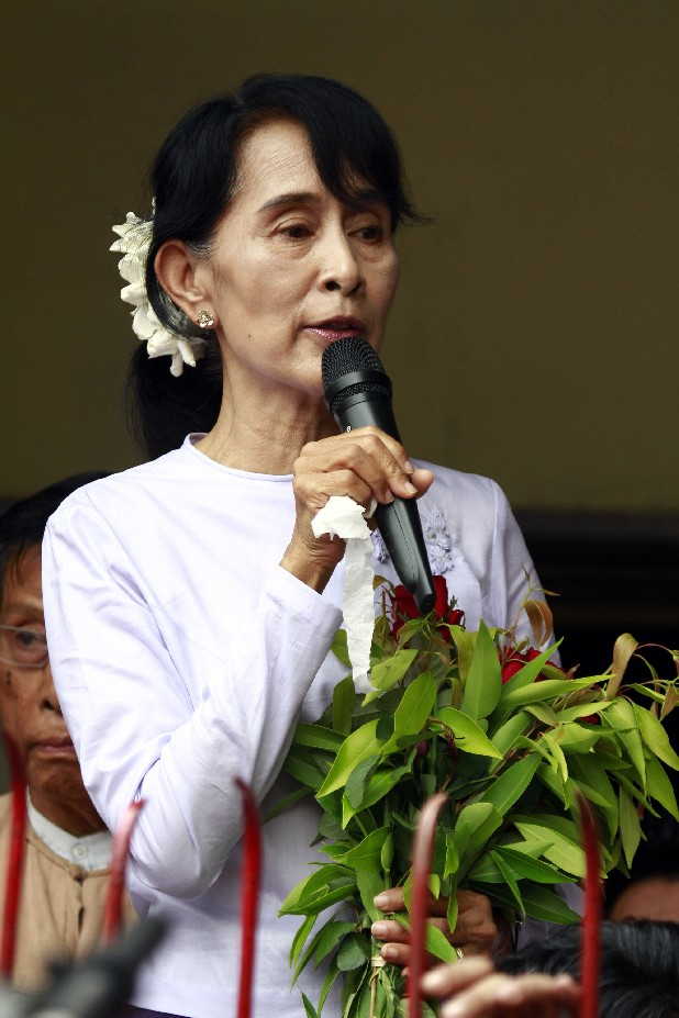 Myanmar pro-democracy leader Aung San Suu Kyi talks to supporters at the headquarters of her National League for Democracy party in Yangon today. Suu Kyi claimed victory Monday in Myanmar's historic by-election, saying she hoped it will mark the beginning of a new era for the long-repressed country. (AP Photo/Khin Maung Win)