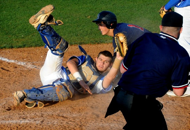 Ringgold catcher Andy Mocahbee looks to the plate umpire after making the tag on Heritage second baseman Lee Gibson in the top of the fifth inning Friday at Ringgold.