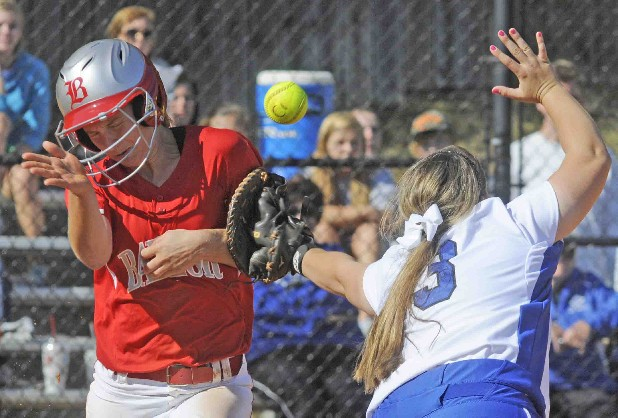 Baylor's Sarah Moore, left, is hit in the back on an errant throw to GPS's Morgan Lane in the top of the fourth inning Thursday at GPS.