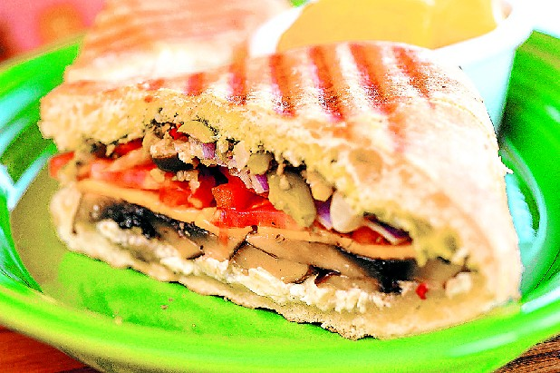Sweet Peppers Deli's Portobello Panini is grilled ciabatta filled with chicken, feta and cheddar cheeses, pesto, tomato, olives, red onion and roasted portobello mushrooms.