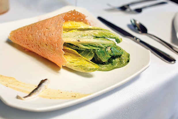 Chato Brasserie's Caesar salad is served inside a handmade parmesan cornucopia with a sprinkling of paprika and a sliver of anchovy.