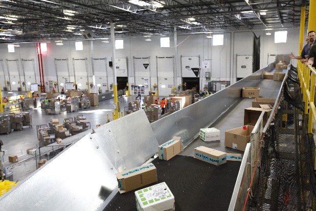 Boxes travel on a conveyor belt in the Chattanooga Amazon fulfillment center.