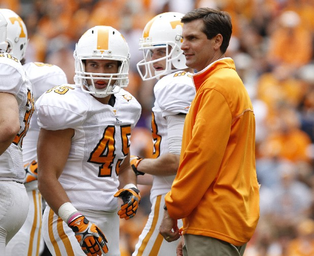Coach Derek Dooley confers with fullback Austin Bolin, No. 45, during the Orange and White game on Saturday.
