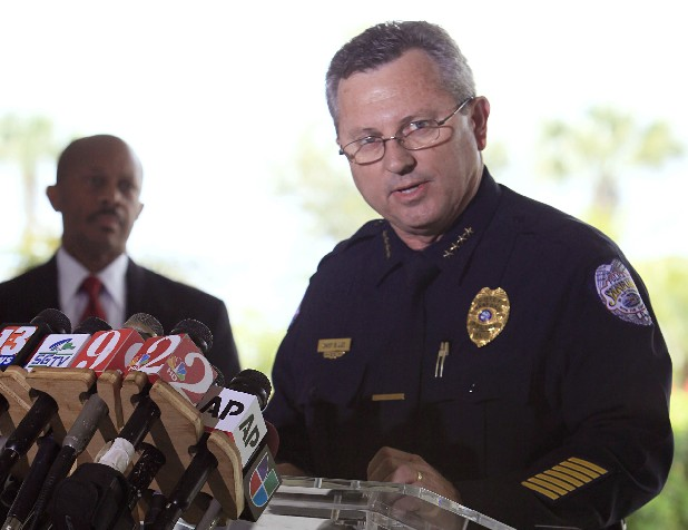 In this March 22, 2012 file photo, Sanford Police Chief Bill Lee speaks to the the media during a news conference as city manager Norton Bonaparte Jr. listens at left, in Sanford Fla. The Sanford City Commission on Monday, April 23, 2012 rejected by a 3-2 vote the resignation of Lee, who was roundly criticized for not initially charging Zimmerman and had stepped down temporarily in March he said to let emotions cool. (AP Photo/Julie Fletcher, File)