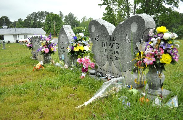 Gravestones mark the location where the late husband and wife, Christopher and Pamela Black, as well as the late son and daughter, Cody and Chesea, rest in the cemetery at New Friendship Baptist Church in Ringgold, Ga. The Blacks were killed in their home when the April 27, 2011, storms tore through the area.
