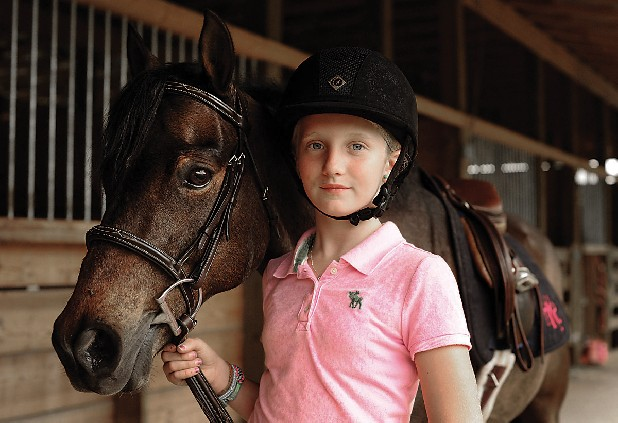 Hailey Kreek (CQ), 11, stands beside her eleven-year-old Welsh medium-sized pony, Galveston Lonestar on Thursday, May 3, 2012, at Heatherfield Horse Park in Trenton, Ga. Kreek has been riding since she was three years old.