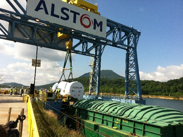 Crews move the first Chattanooga-manufactured natural gas turbine onto a barge at the Alstom facility Tuesday. The turbine will be shipped to Mexico.