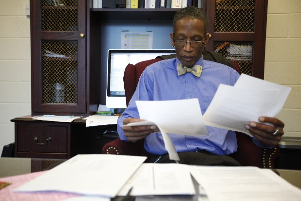 Orchard Knob Elementary principal LaFrederick Thirkill sorts through papers in his office in Chattanooga on Monday. Thirkill will be offering a summer school program this year called the East Chattanooga Improvement Technology & Youth Leadership Academy.