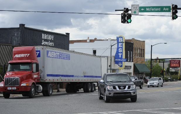 A tractor-trailer drives through the intersection of Rossville Boulevard. and McFarland Avenue in Rossville. The Rossville City Council passed an ordinance on Monday banning the trucks on McFarland because of complaints from residents and maintenance concerns.