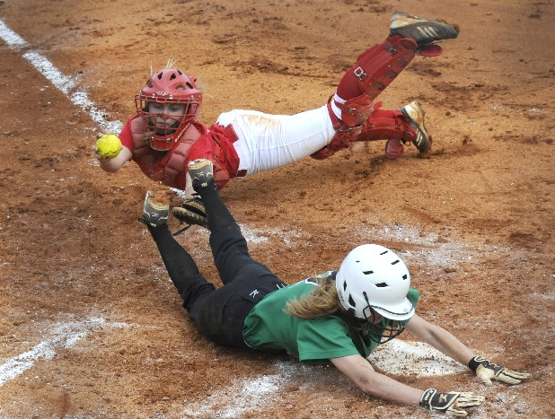 East Hamilton's McKenzie Mayes (2) slides past Polk County's Lily Cuzzort for the score as the catcher tags with the glove in Tuesday's game at East Hamilton.
