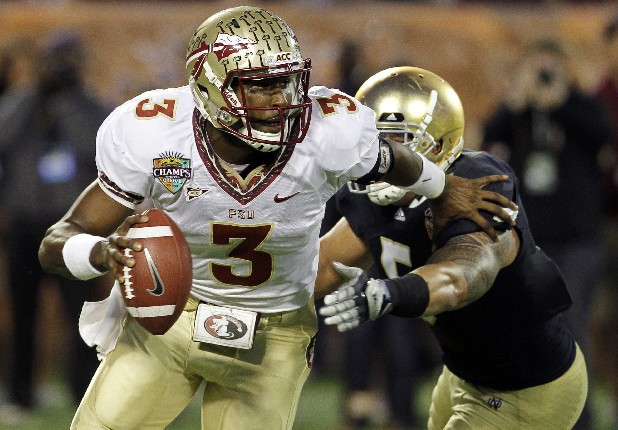 Florida  State quarterback EJ Manuel (3) scrambles as he is pressured by Notre Dame linebacker Manti Te'o (5) during the first half of the Champs Sports Bowl NCAA college football game, Thursday, Dec. 29, 2011, in Orlando, Fla. (AP Photo/John Raoux)