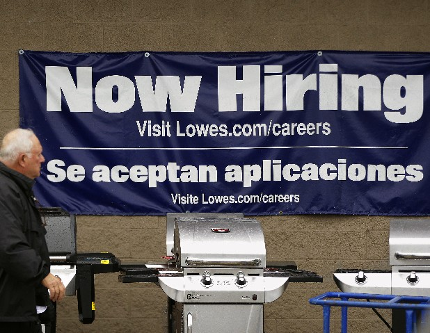 A Lowes store advertises job openings and gas grills outside the home improvement store in Pembroke, Mass.